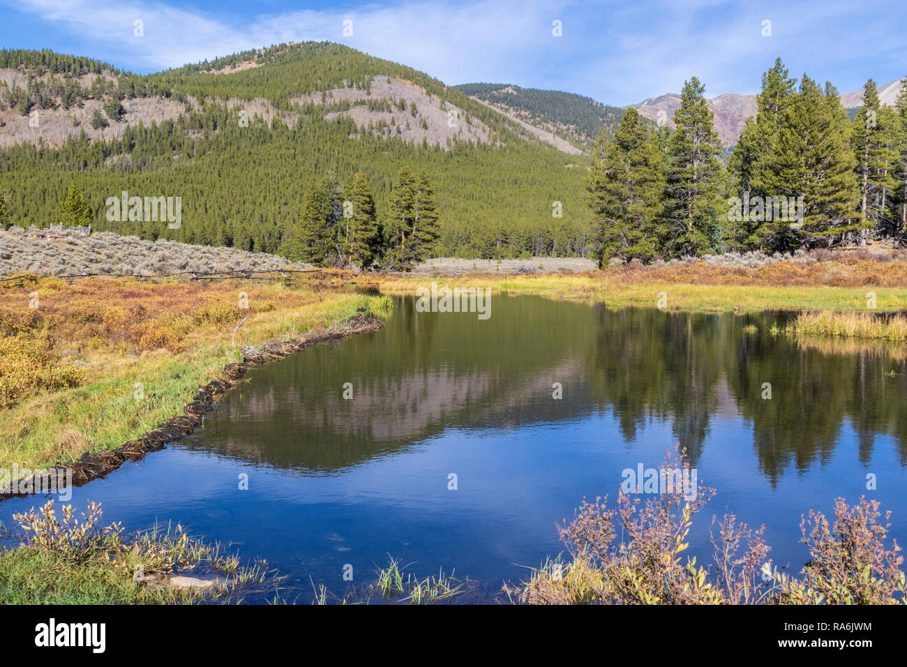 Lake by cemetery in Historic Tin Cup community in Colorado, a rural area with limited access in winter. - Stock Image