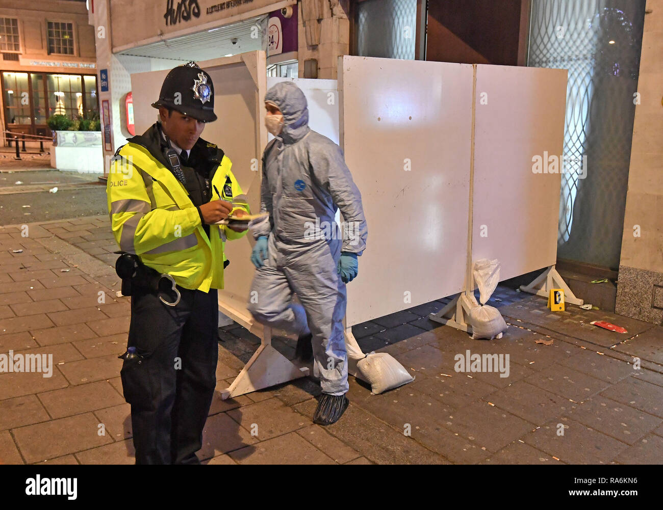 Police And Forensic Investigators At A Property In Park Lane London After A Security Guard Was Stabbed To Death And Three Others Injured As They Tried To Bar A Group Of Men