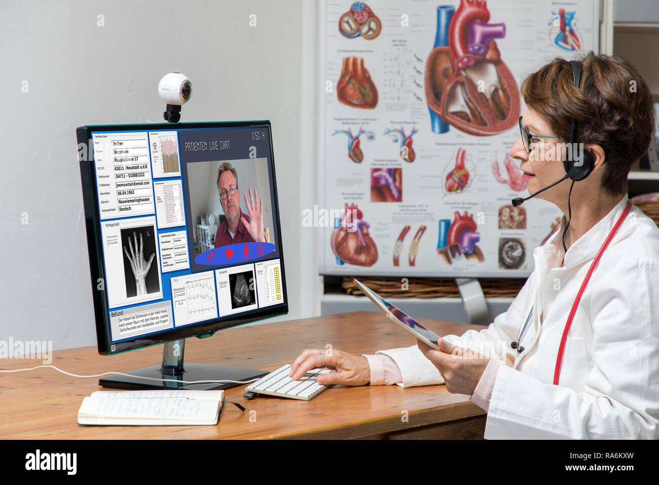 Symbol photo for telemedicine, doctor in a practice, communicates with the patient via a webcam, patient data and findings on - Stock Image