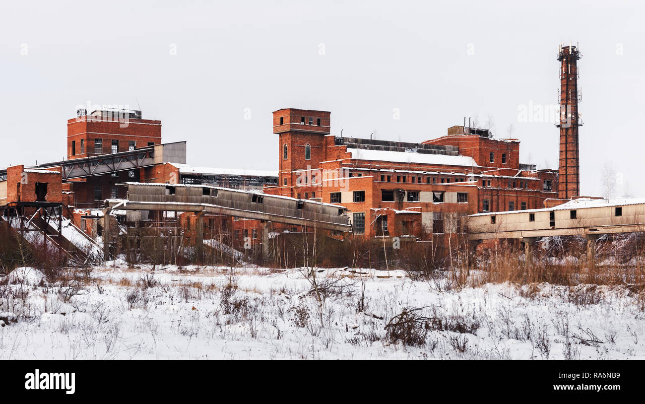Old ruined factory construction in winter time. Urban exploration photography Stock Photo