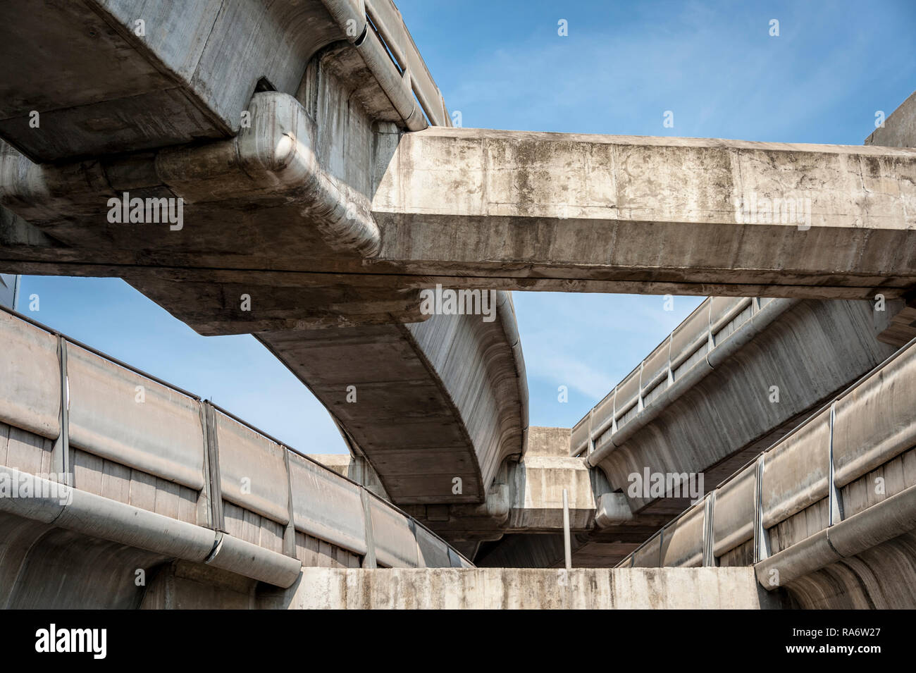 large and imposing concrete overpasses against a blue sky, Bangkok Thailand - Stock Image