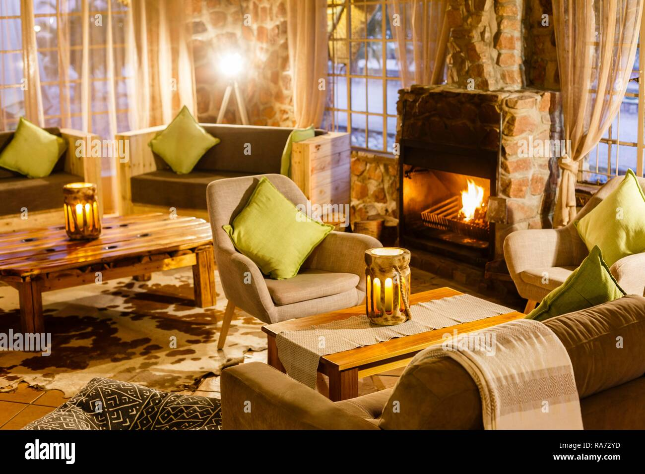 Cosy sitting area with fireplace, Elegant Desert Lodge, Sesriem, Namibia - Stock Image