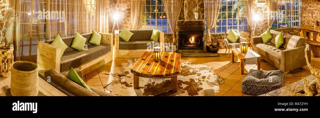 Cosy sitting area with fireplace, panorama, Elegant Desert Lodge, Sesriem, Namibia - Stock Image