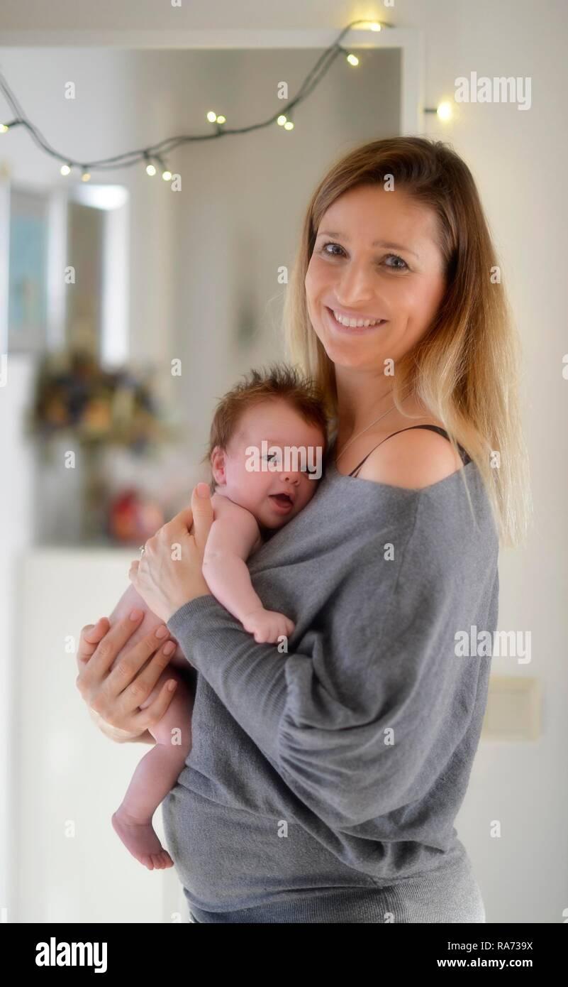 Mother, keeping infant, 6 weeks, Baden-Württemberg, Germany - Stock Image