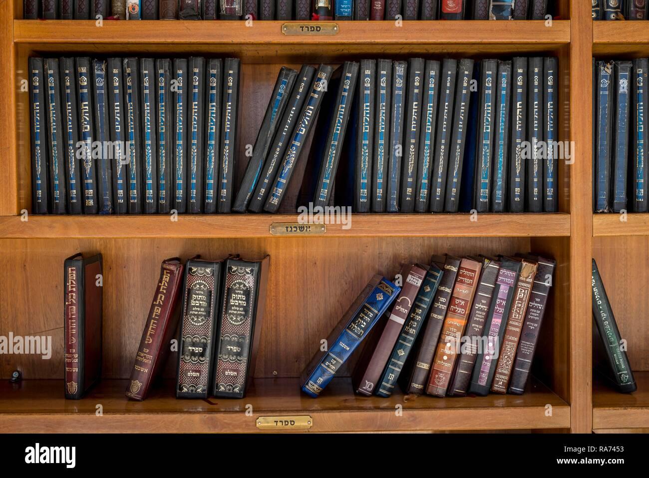 Hebrew books on the shelf, Old synagogue, David's tomb, tomb of the biblical king David, David's city, Jerusalem, Israel - Stock Image