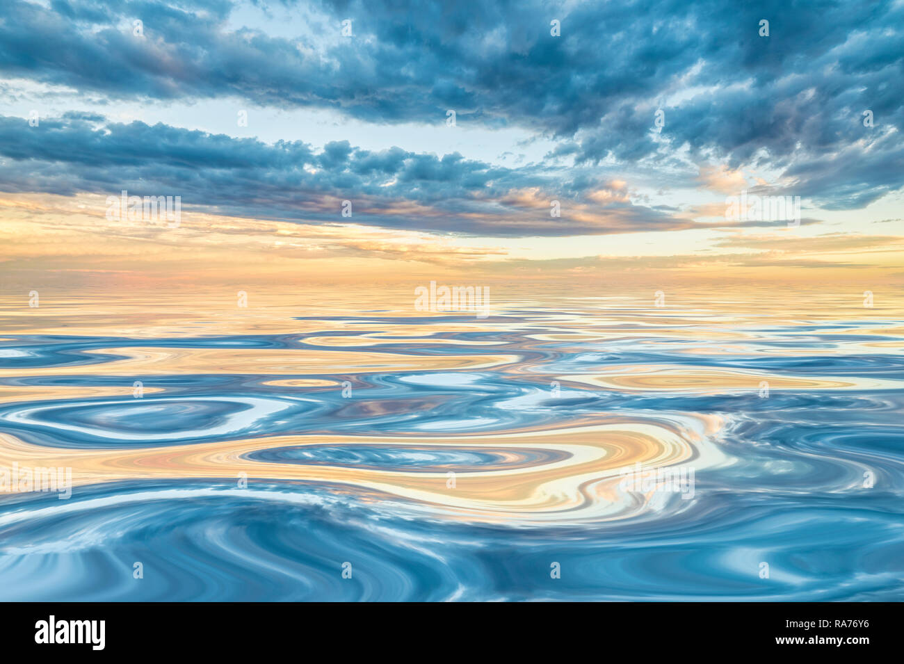 Dawn or dusk on smooth water - Stock Image