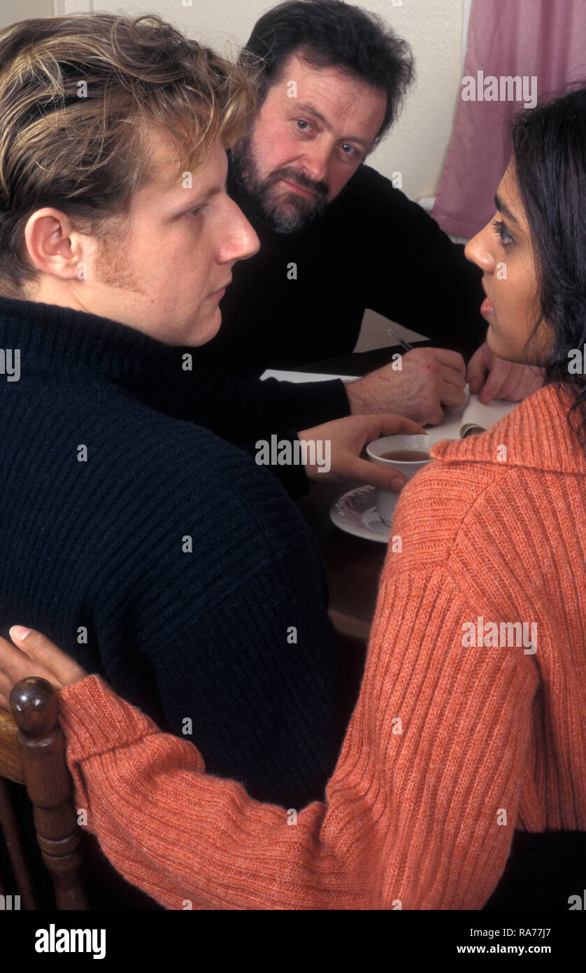 bi-racial couple (Anglo-Asian woman and caucasian partner) having counselling - Stock Image
