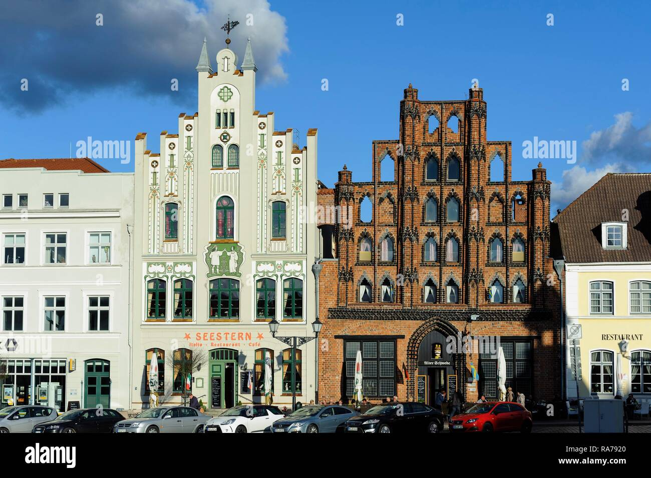 Historic houses on Marktplatz square with the 'Alter Schwede' restaurant from the 14th century, historic town centre of Wismar, UNESCO World Cultural  - Stock Image