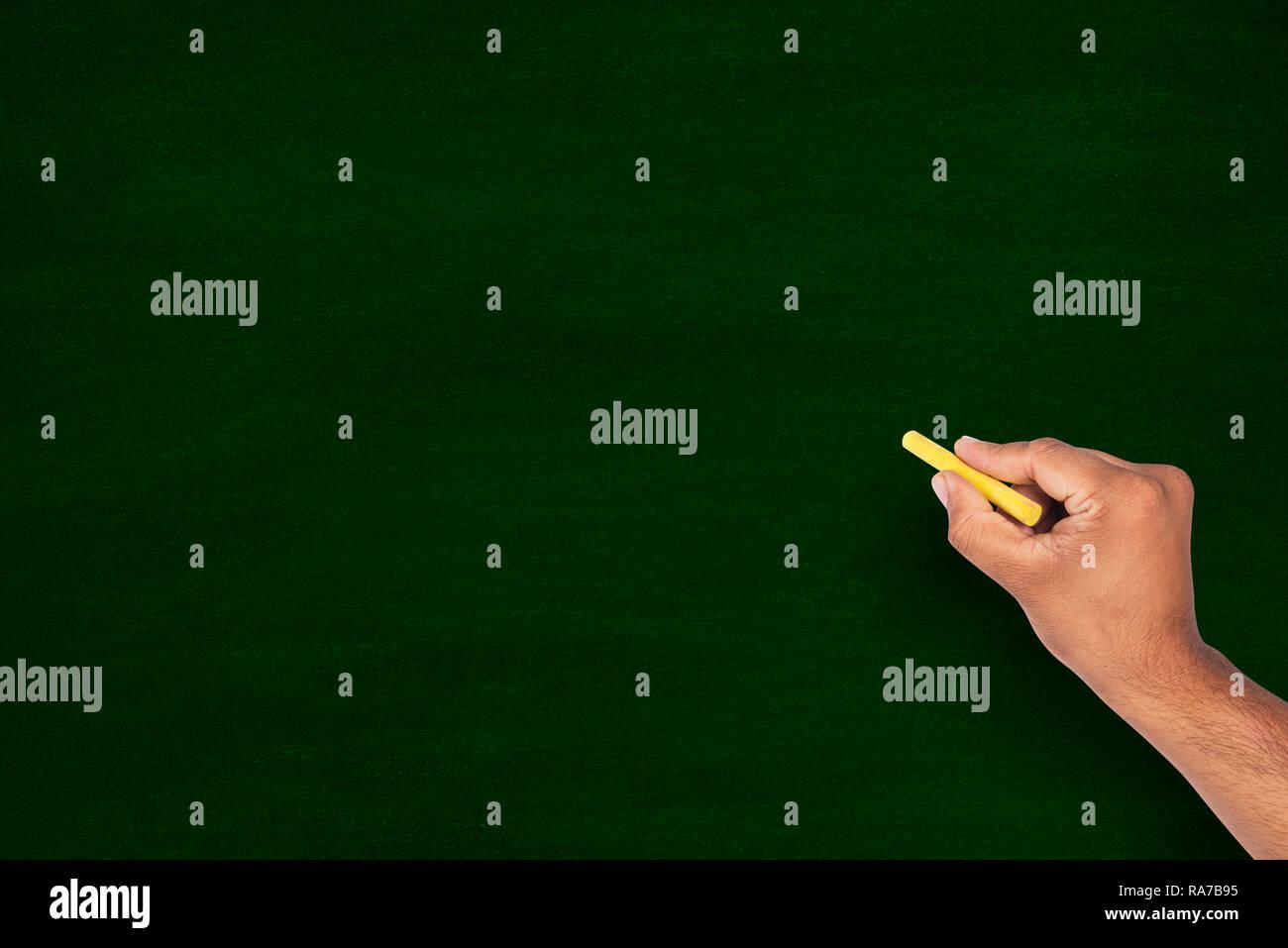 Hand writing on chalkboard / blackboard - Stock Image