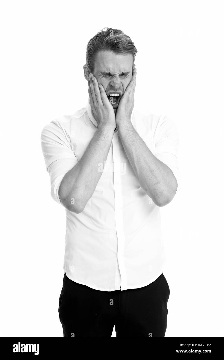 Overwhelmed concept. Man yawning face formal shirt white background. Man tired stressful yawn keep eyes closed. Guy with opened mouth yawns cover mouth hands. Stressful work in office. - Stock Image