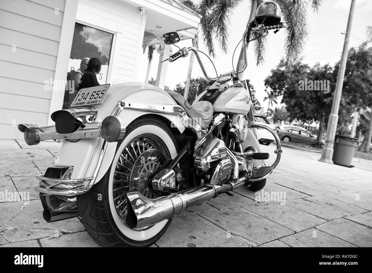 George Town, Cayman Islands - February 06, 2016: harley davidson motorcycle parked at house. motorcycle. travelling on cool motorcycle. Motorcycle club. Wanderlust - Stock Image