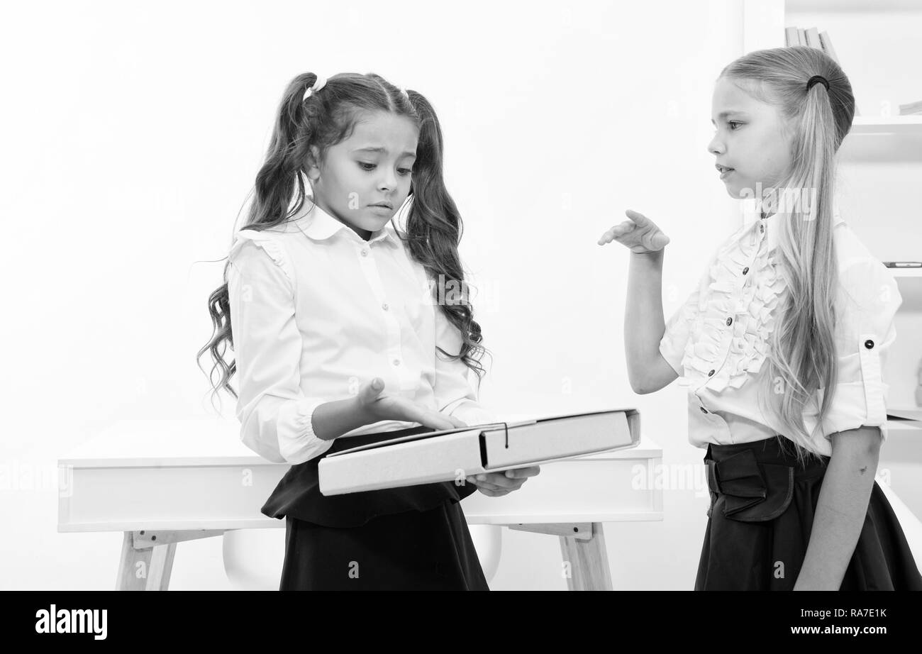 Little girls discuss problem on school day. little girls work on problem solution in classroom. Stock Photo