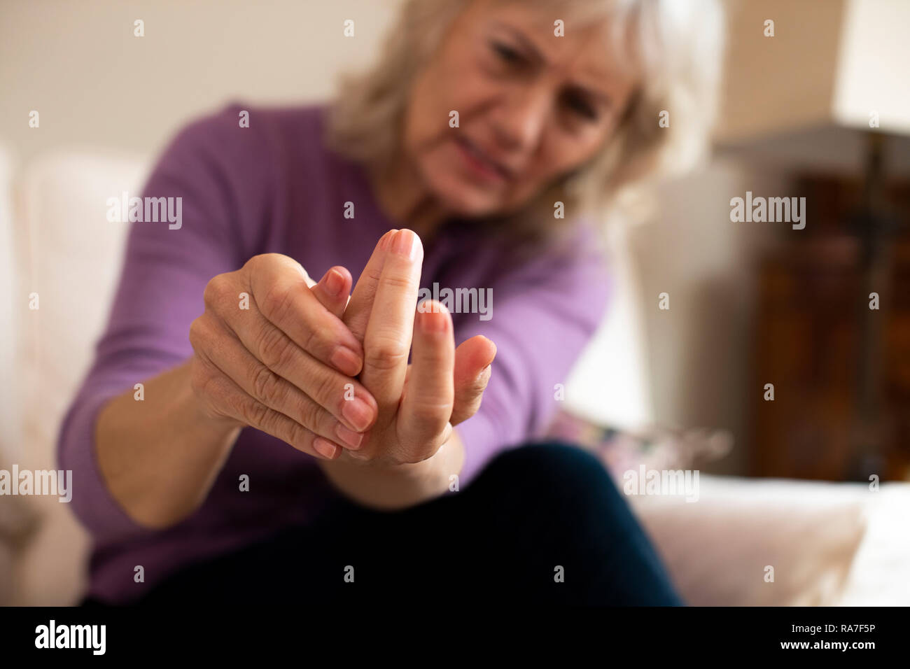 Senior Woman At Home Suffering With Arthritis - Stock Image
