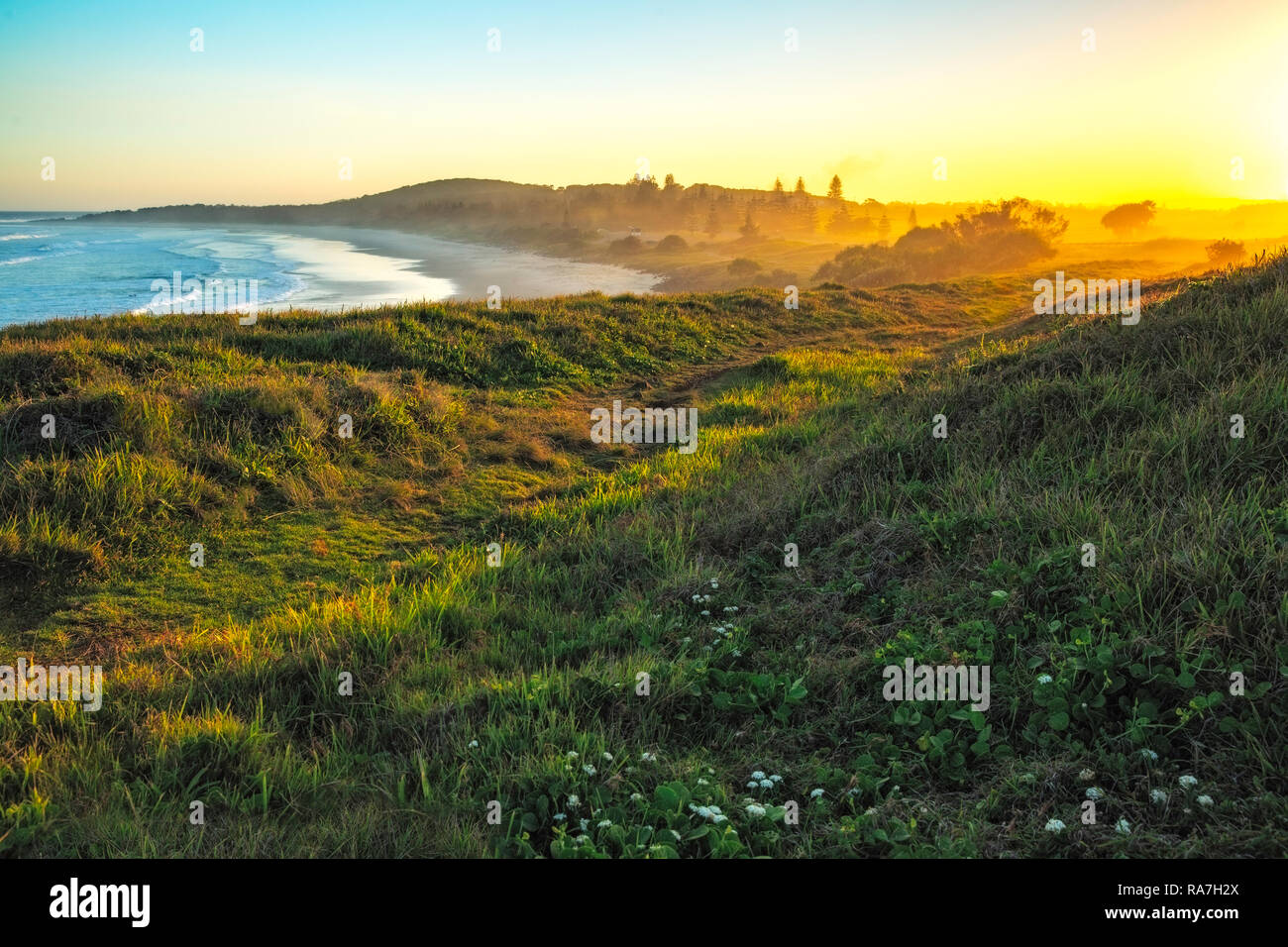 Rural farmland meets the coast, The beautiful foot track leads down to the beautiful beach of Skennars Head onward to Flat Rock and Ballina. - Stock Image