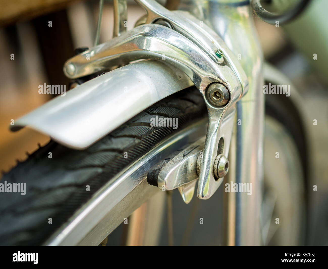 Close-up bicycle brakes and wheel on green vintage bicycle Stock