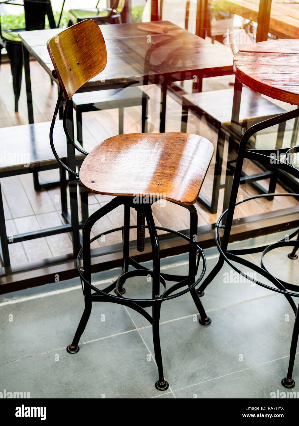 Phenomenal Wooden Vintage Bar Stool With Black Steel Legs In Cafe Cjindustries Chair Design For Home Cjindustriesco