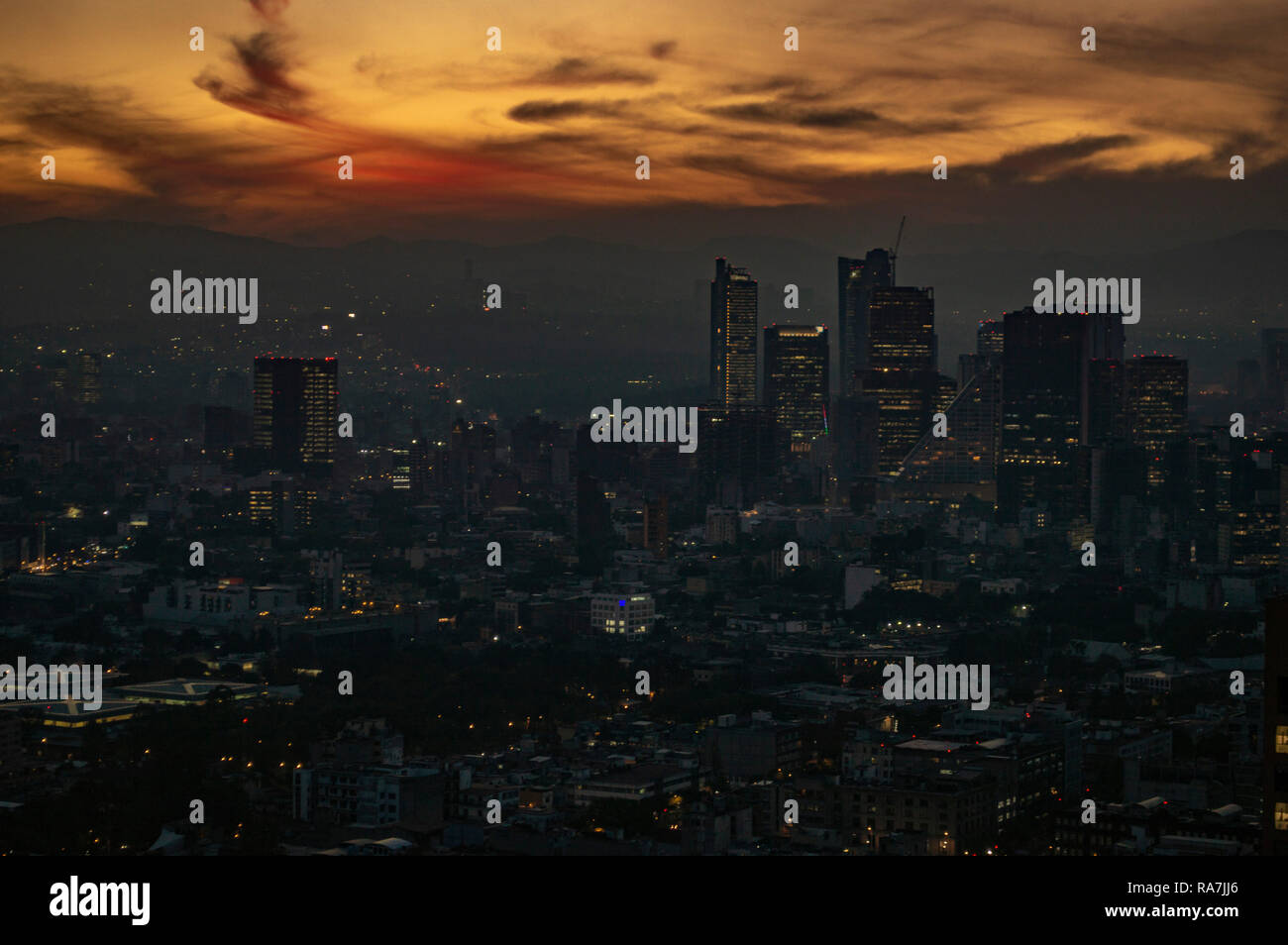 A view of west Mexico City, Mexico, at dusk - Stock Image