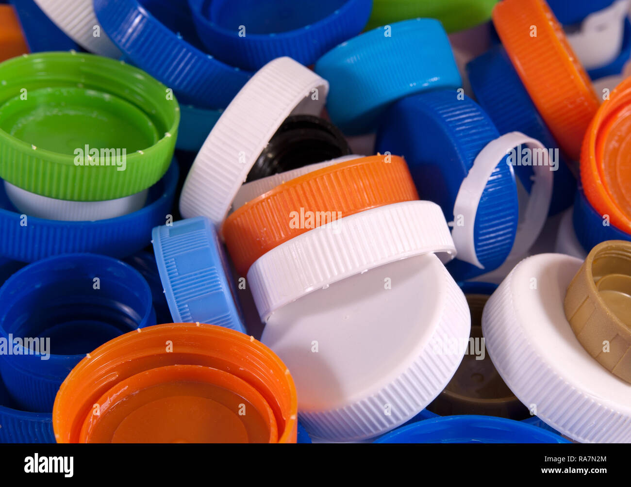 Plastic bottle caps as a background. Close up image - Stock Image