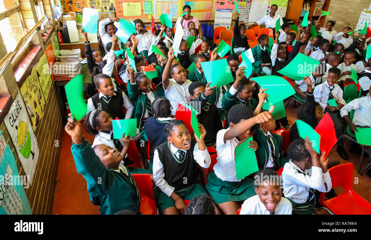 Child Raising Hand In Classroom Stock Photos Child Raising Hand In