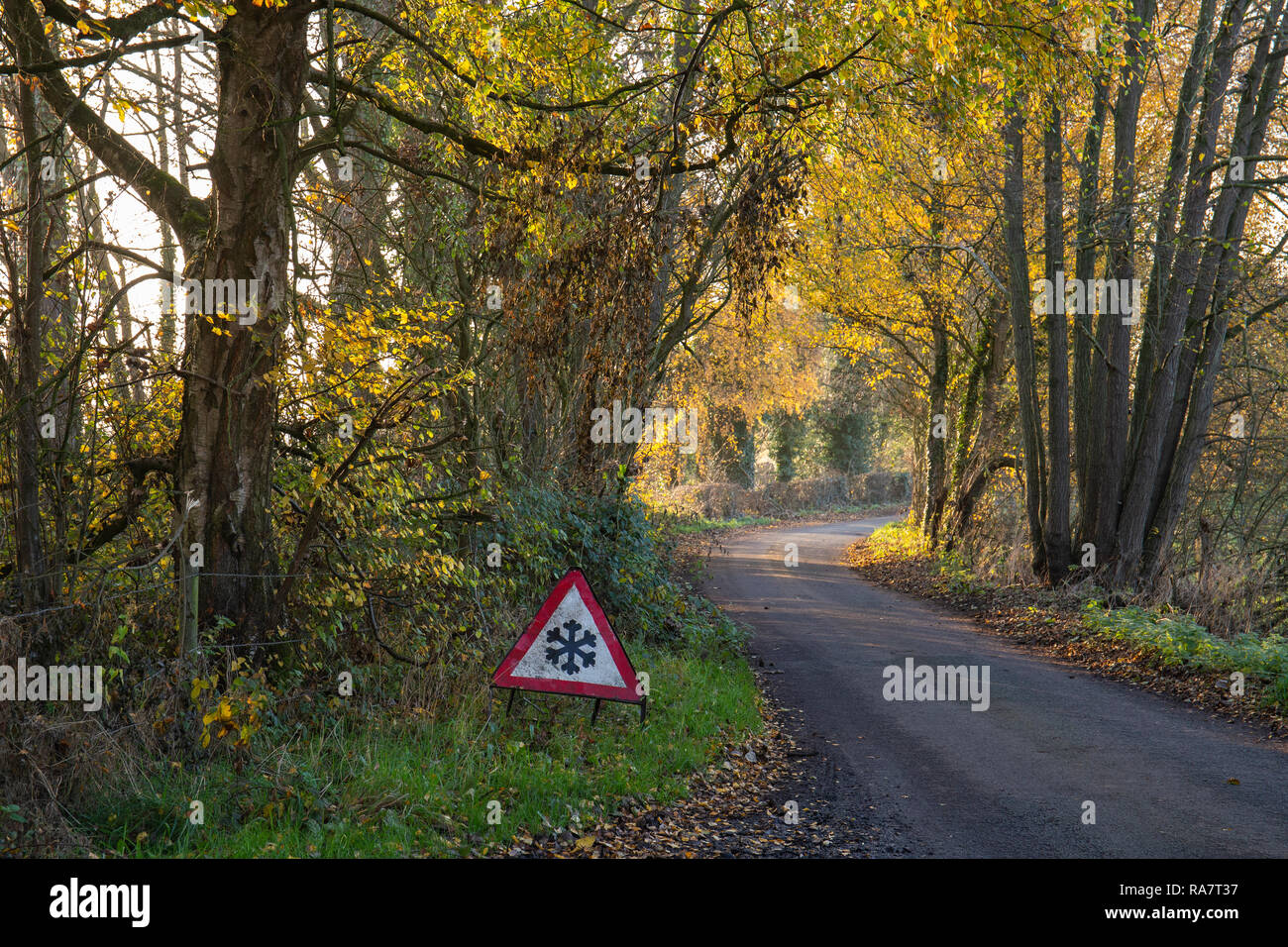 Ice on road traffic warning sign in the Cheshire countryside - Stock Image