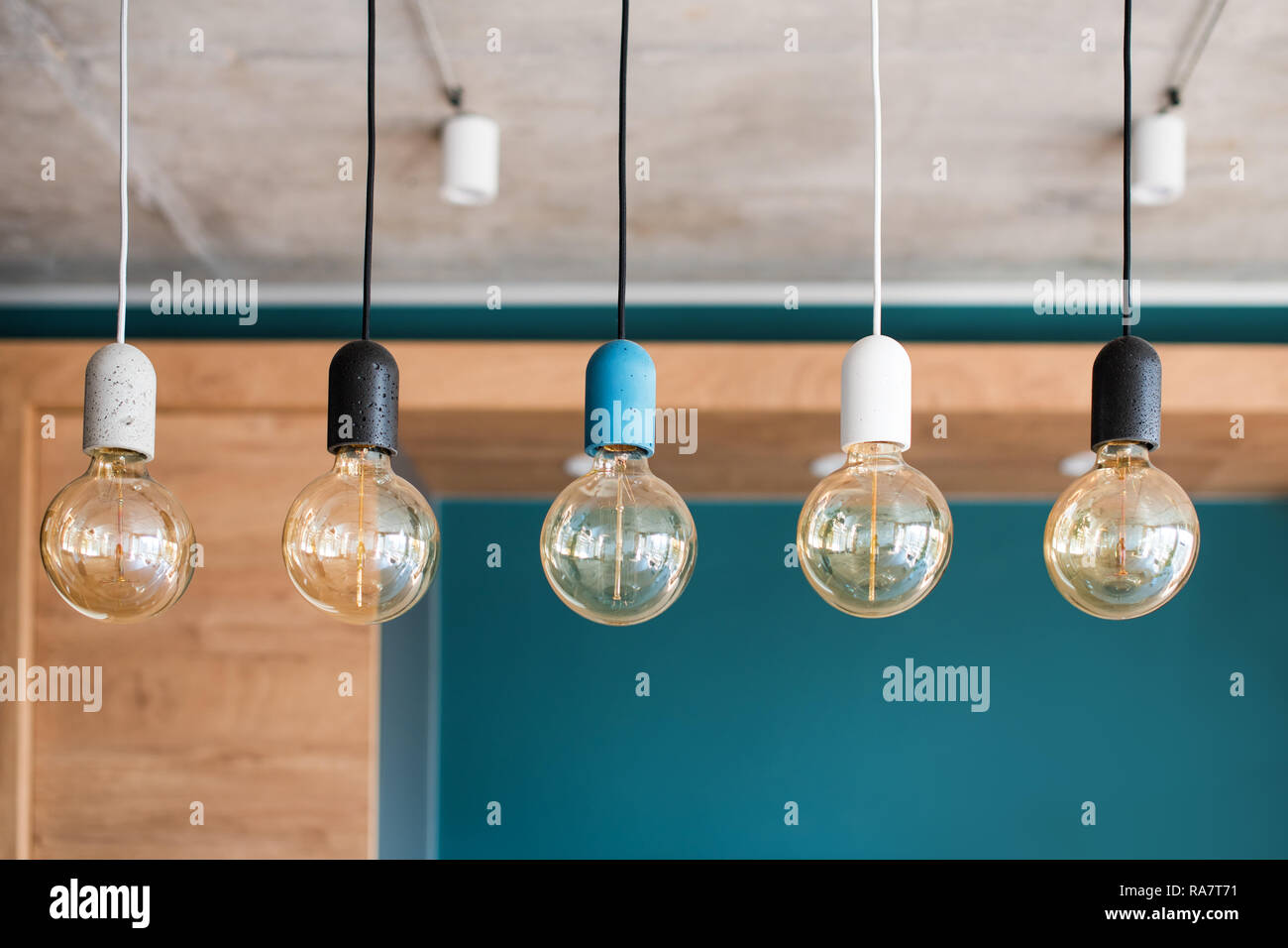 Edison retro lamps. Incandescent bulbs on grey wall background in loft. Concept of vintage style Stock Photo