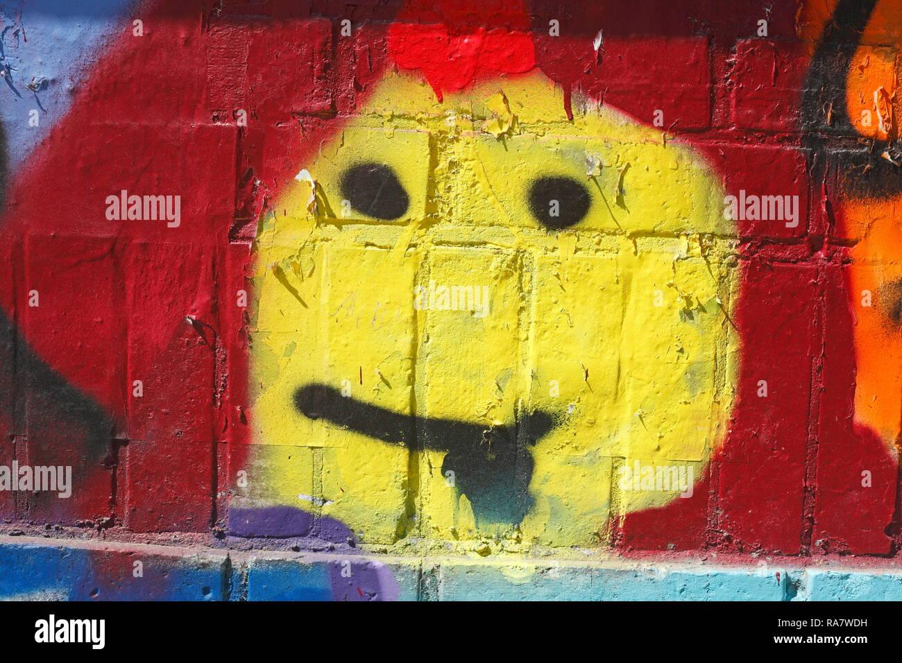 Yellow smiley, Colorful brick wall, Germany, Europe I Gelber smiley, Bunte  Ziegelsteinmauer, Deutschland, Europa I Stock Photo