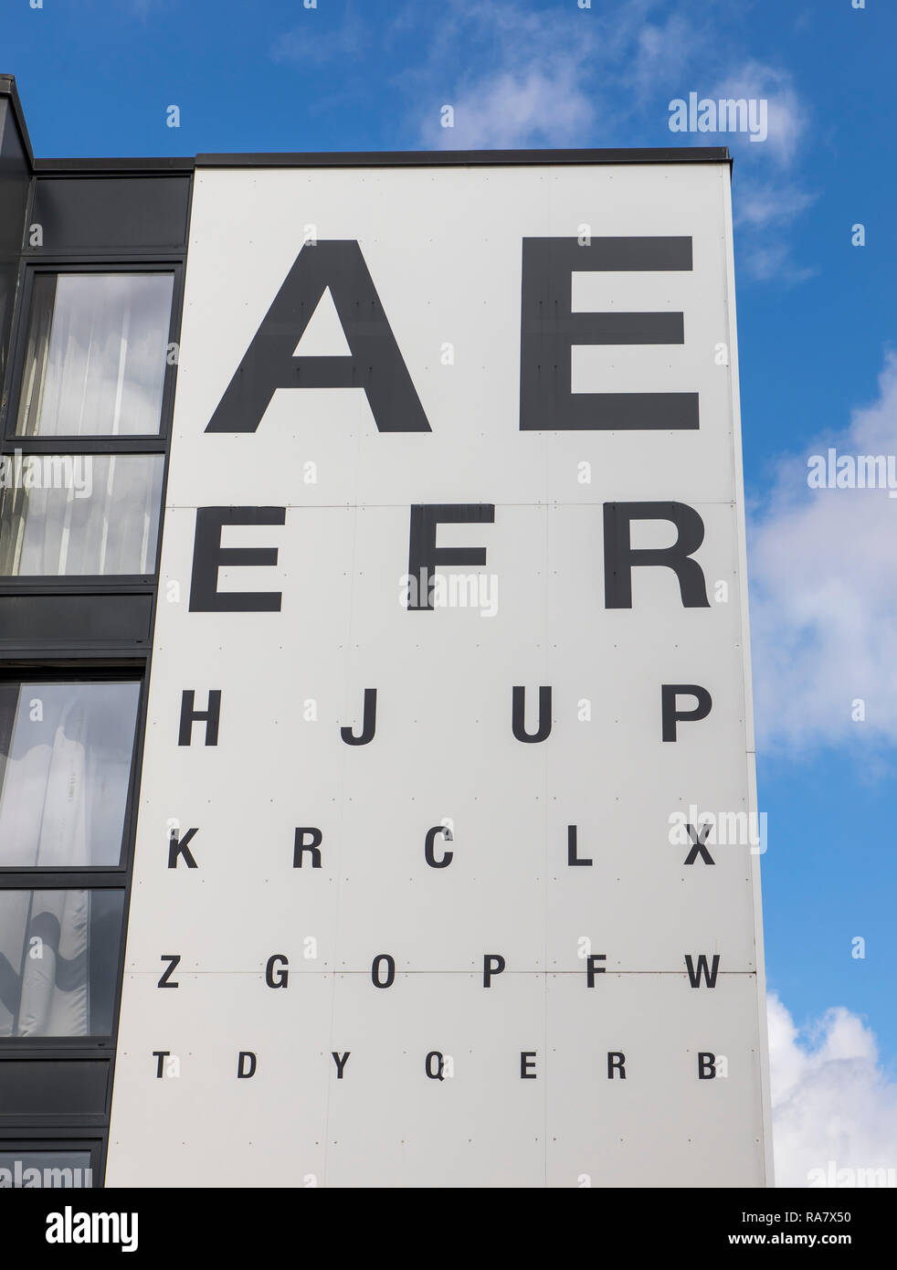Advertising board of an optician, on the house facade, letter board, - Stock Image