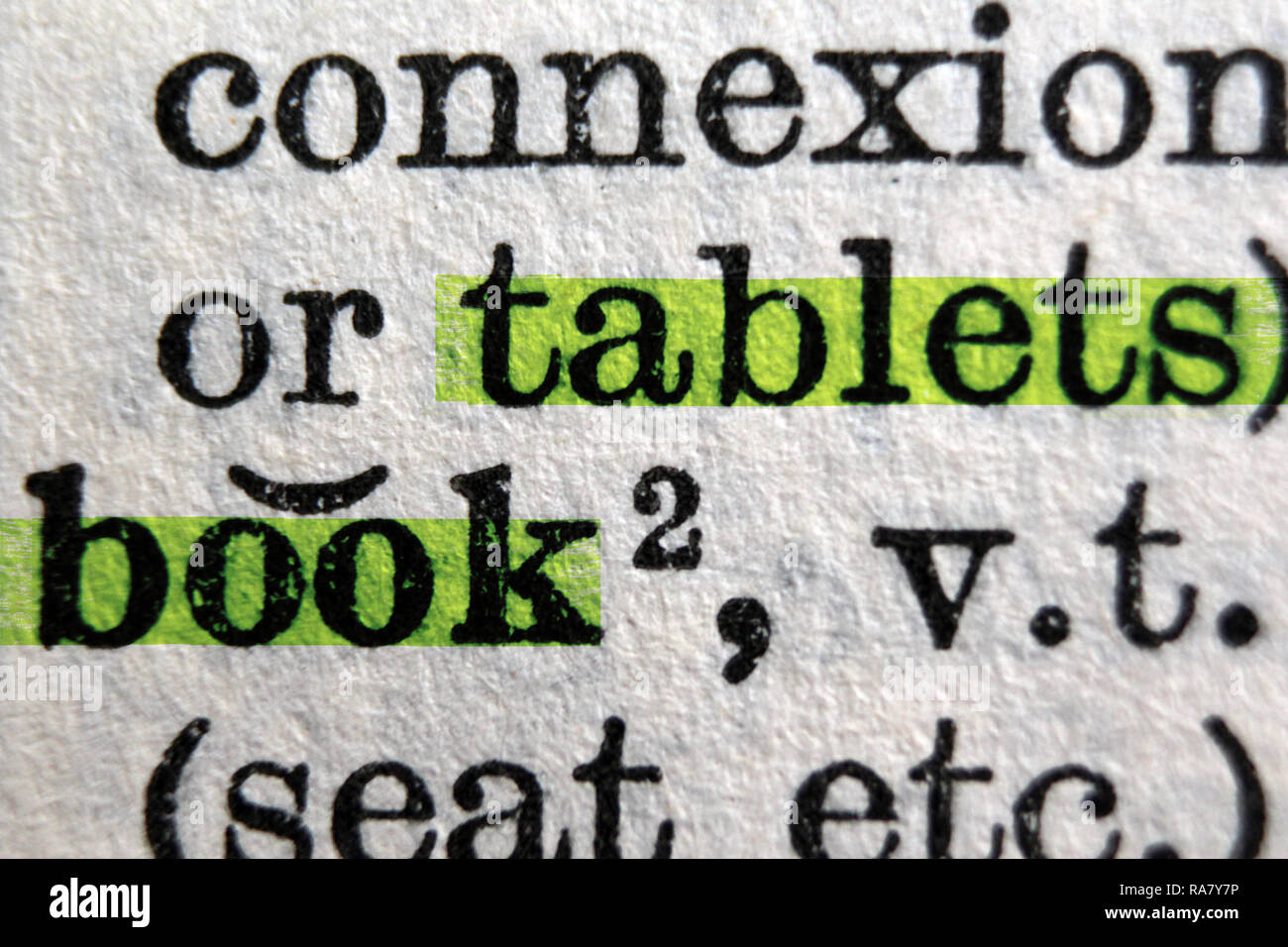 Connexion, tablets and book words highlighted on Oxford English Dictionary, close up - Stock Image