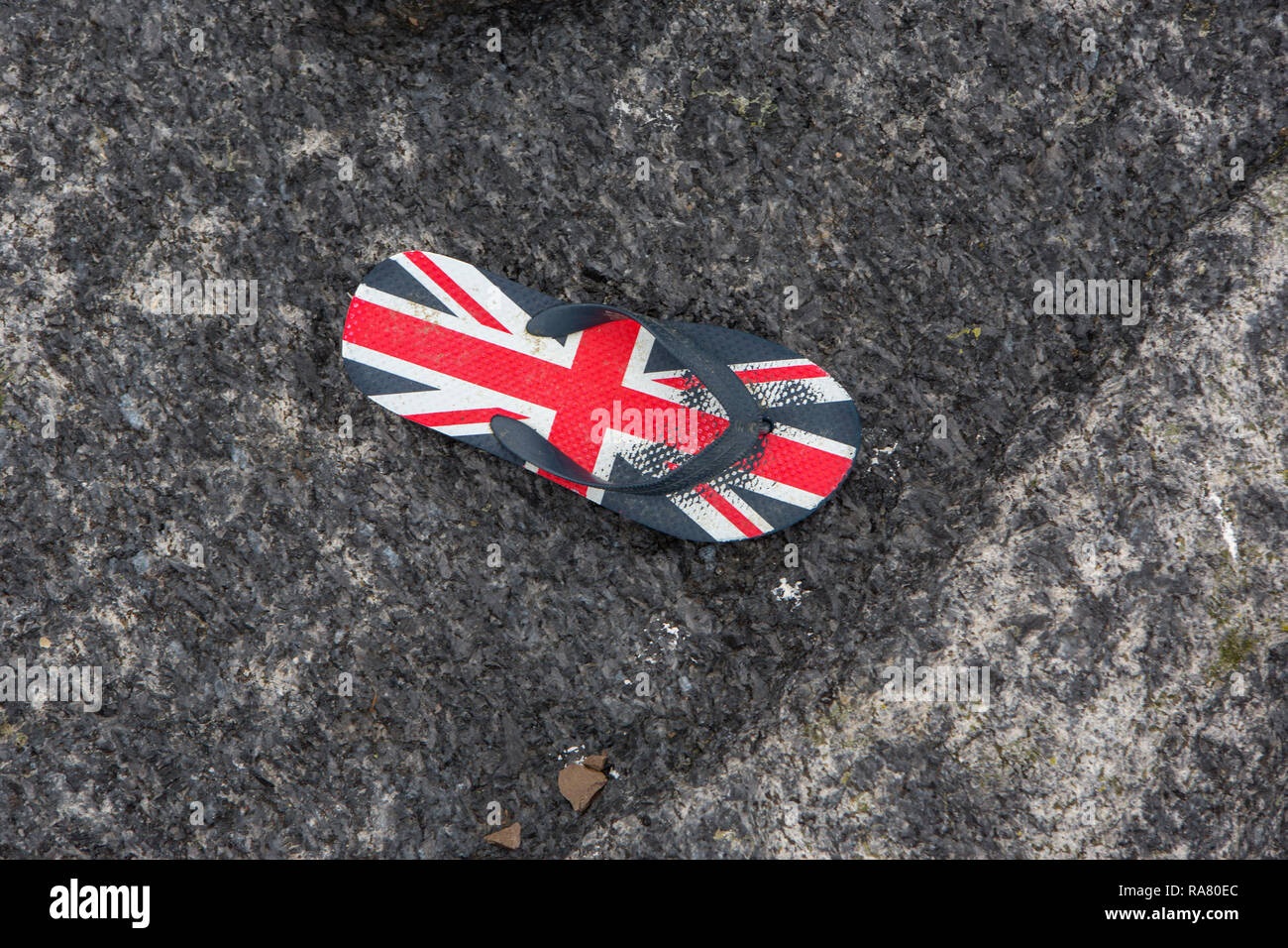 A worn Union Jack flip flop - Stock Image