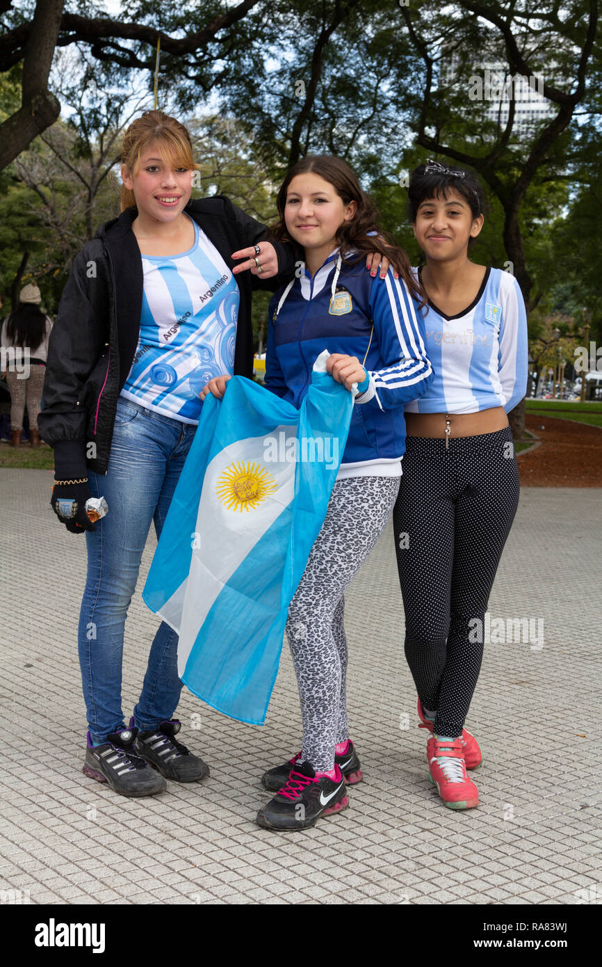 Buenos Aires State/Argentina 25/06/2014. Three females Argentina soccer team fans posing with argentina flag during The soccer world cup 2014 Argentin - Stock Image