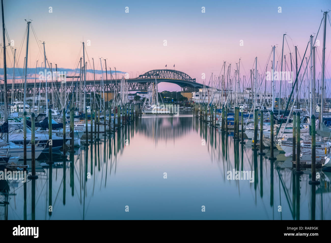 Auckland Marina Sunset Long Exposure in front of the Auckland Harbour Bridge - Stock Image