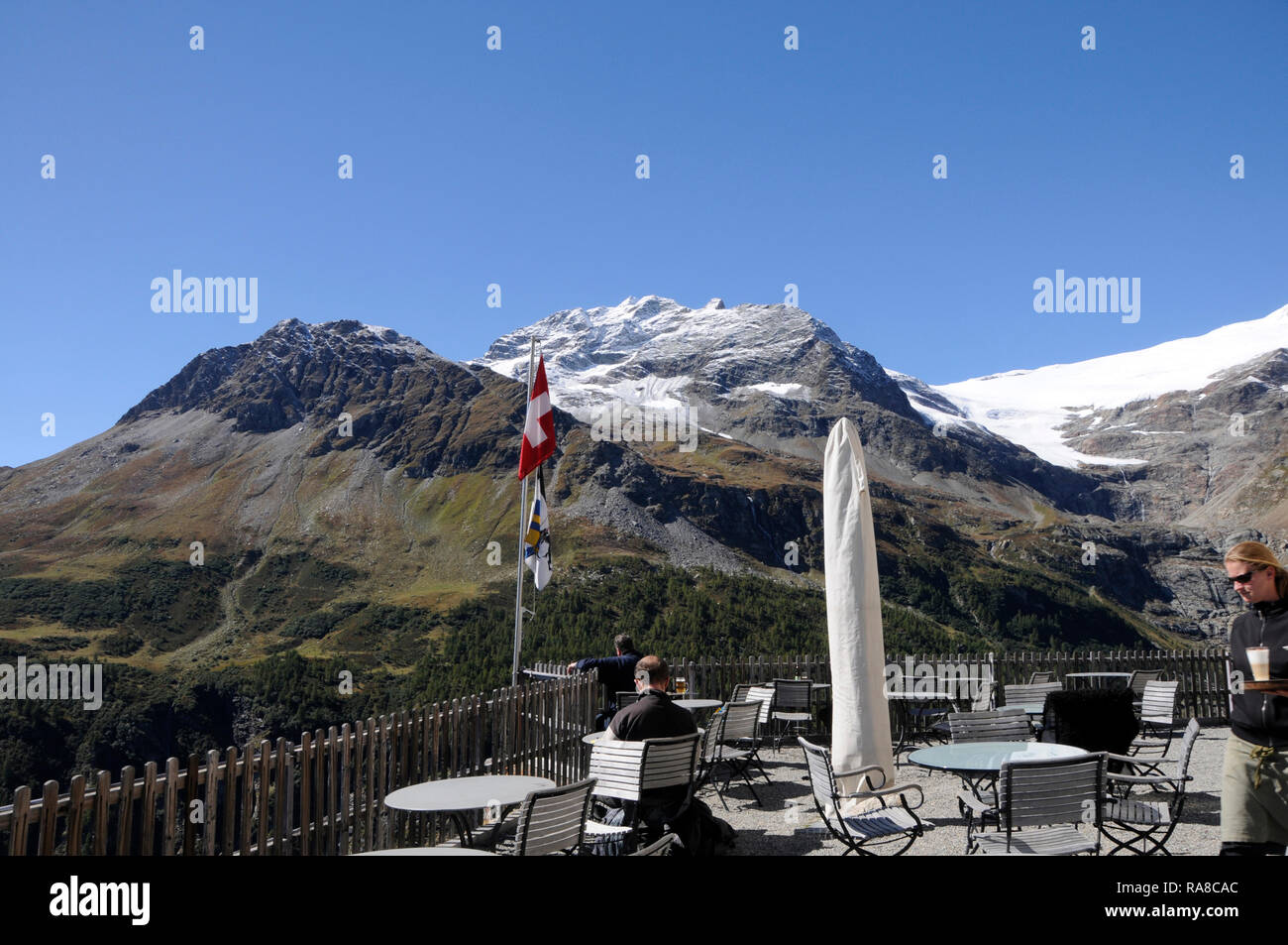 Mountain-Restaurant on top of Alp Grüm with perfect view to Posciavo. - Stock Image