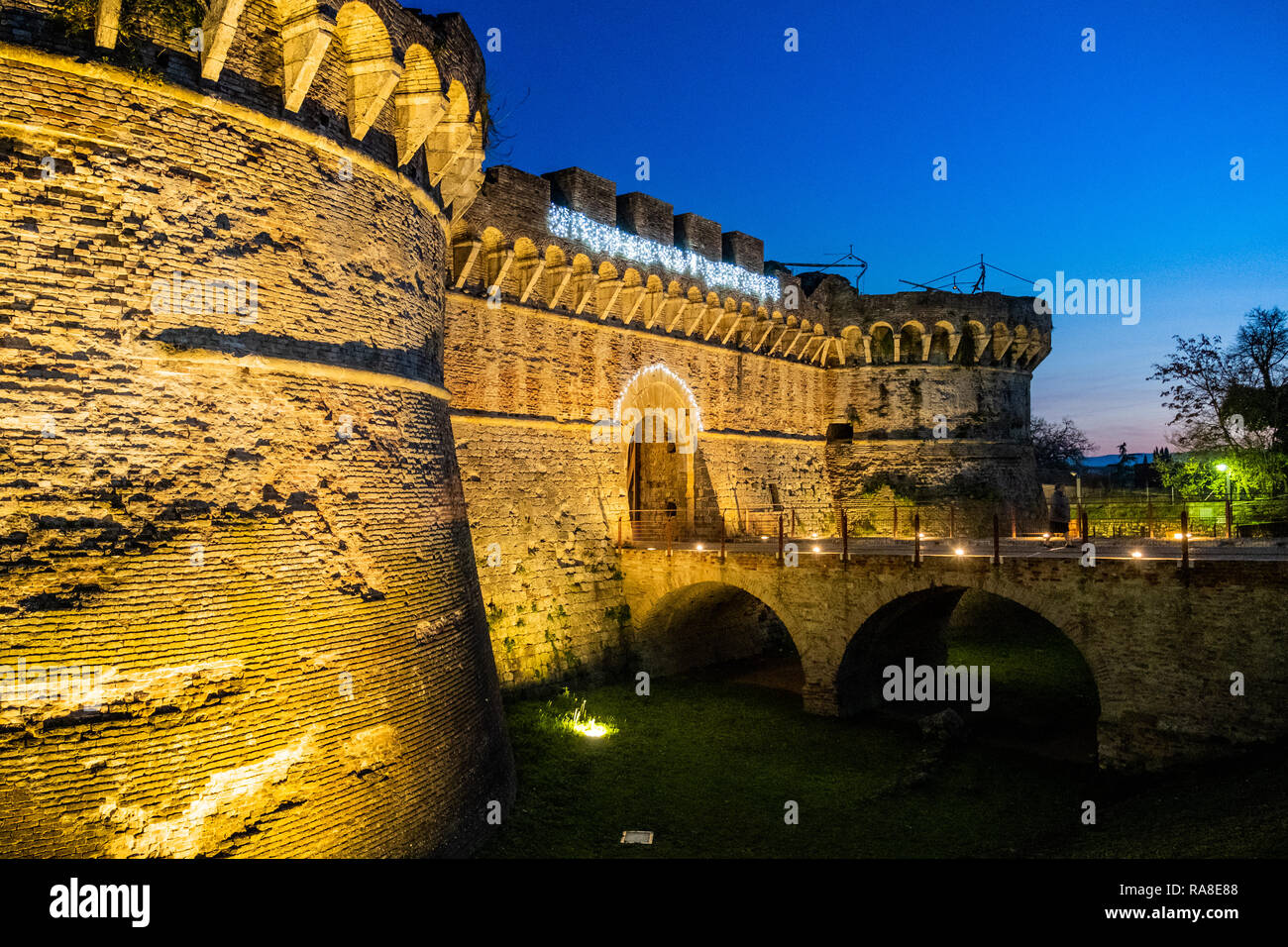 Porta Nuova (or Porta Salis) by night with the two Renaissance circular towers built in the XV-XVI century, is one of the gates to the medieval villag Stock Photo