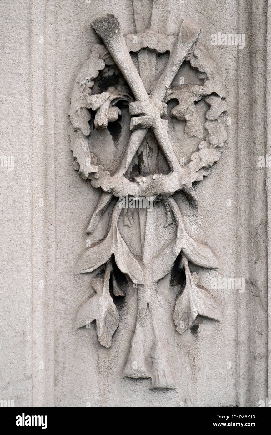 A Carving On The Stone Gateway Into A Church Yard In London - Stock Image