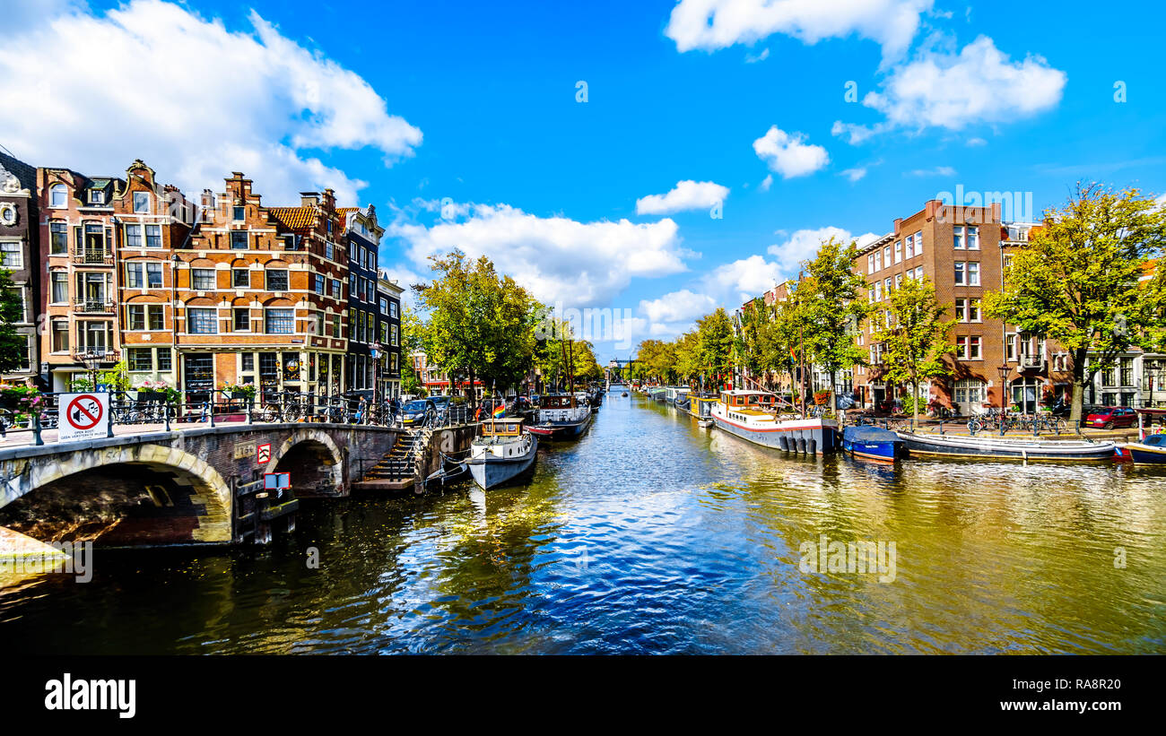 View of the Prinsengracht canal from the Papiermolensluis bridge in the city center of Amsterdam in the Netherlands - Stock Image