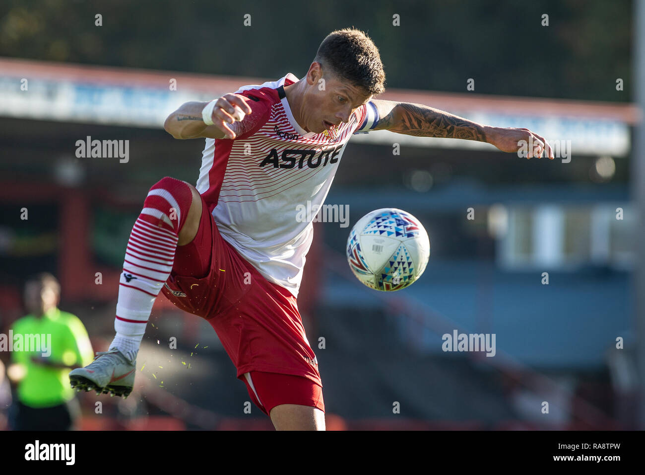 Alex Revell, striker for Stevenage Football Club brings ball under control. - Stock Image