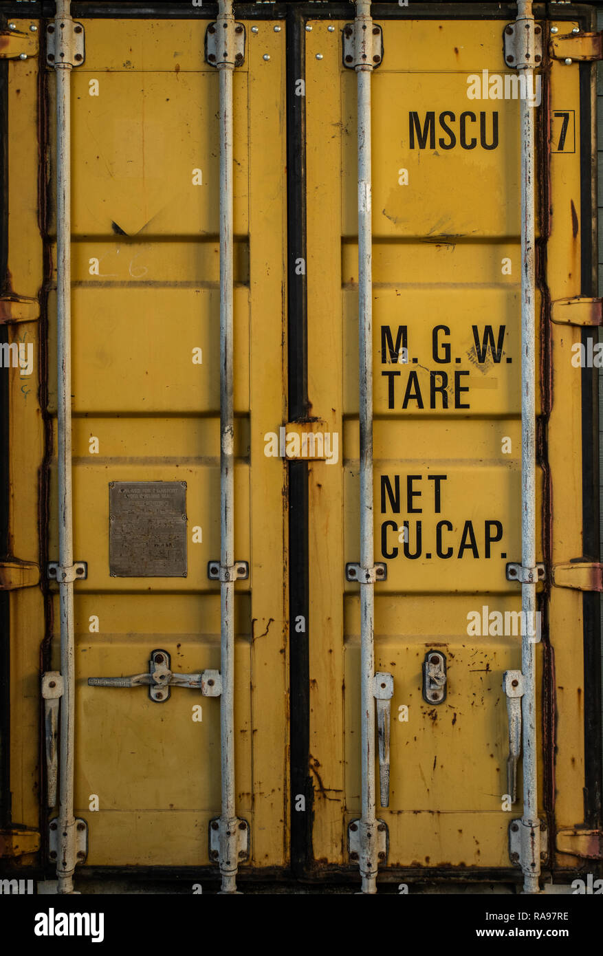 The door of an old yellow cargo shipping container Stock Photo