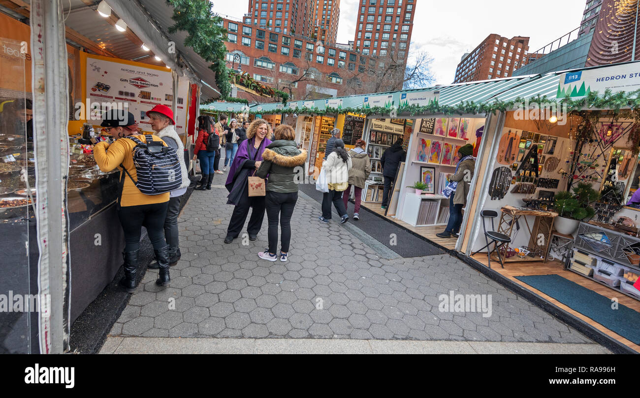 Shoppers and tourists exploring the Union Square Holiday Market in Union Square, New York City. - Stock Image