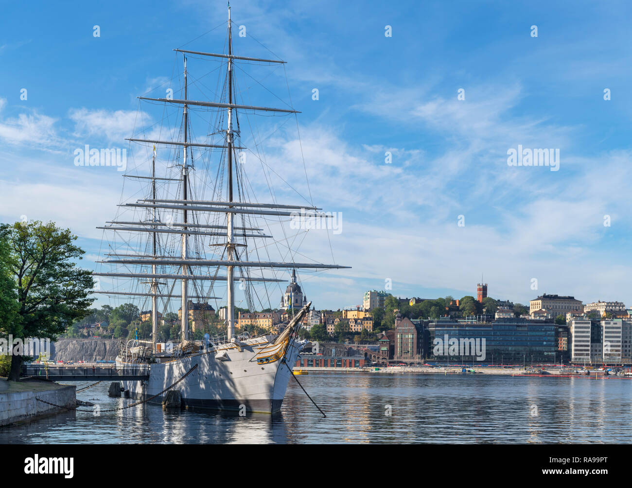 The af Chapman full rigged sailing vessel, now a youth hostel, Skeppsholmen looking towards Stadsholmen, Stockholm, Sweden - Stock Image