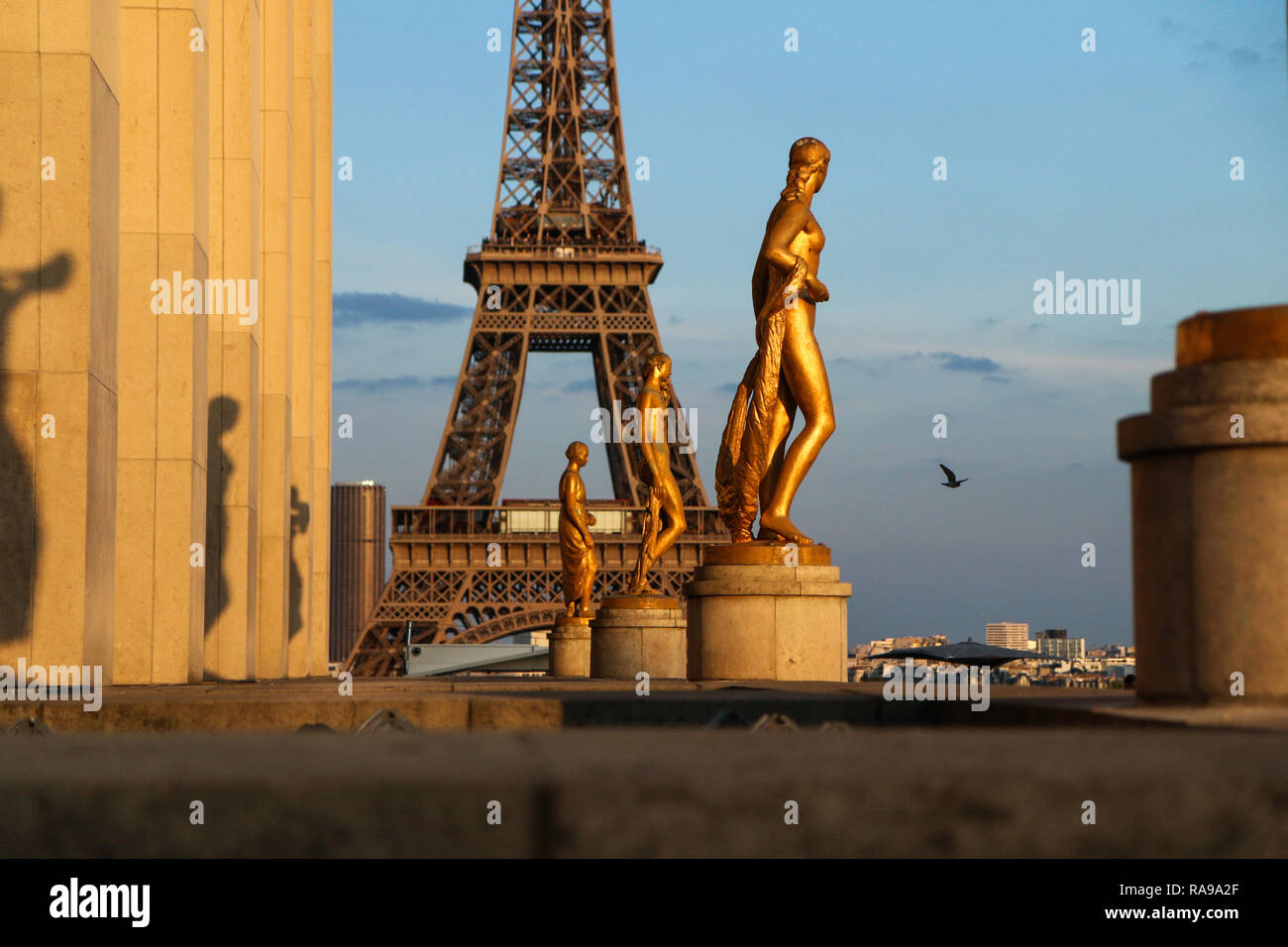 A detail of the statues at Trocadero in Paris. The Eiffel tower is in background. - Stock Image