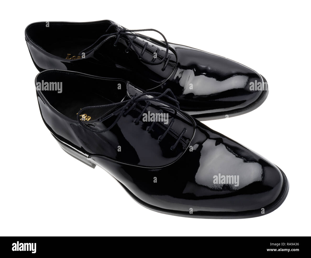 Black patent leather shoes for special events. - Stock Image