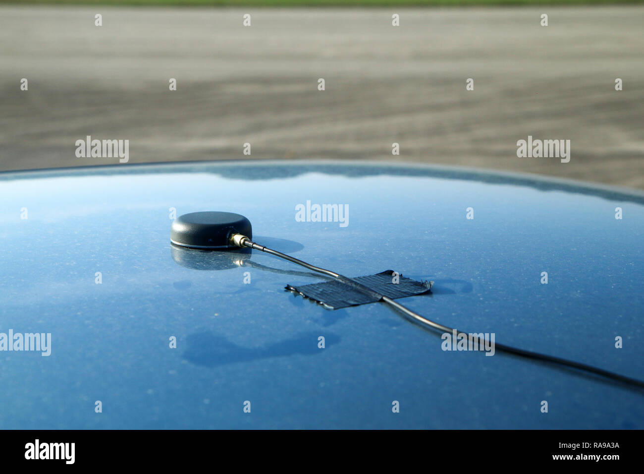 A detail of a gps antenna placed on the roof of a vehicle. Used for the precise measurement of vehicle´s position. - Stock Image