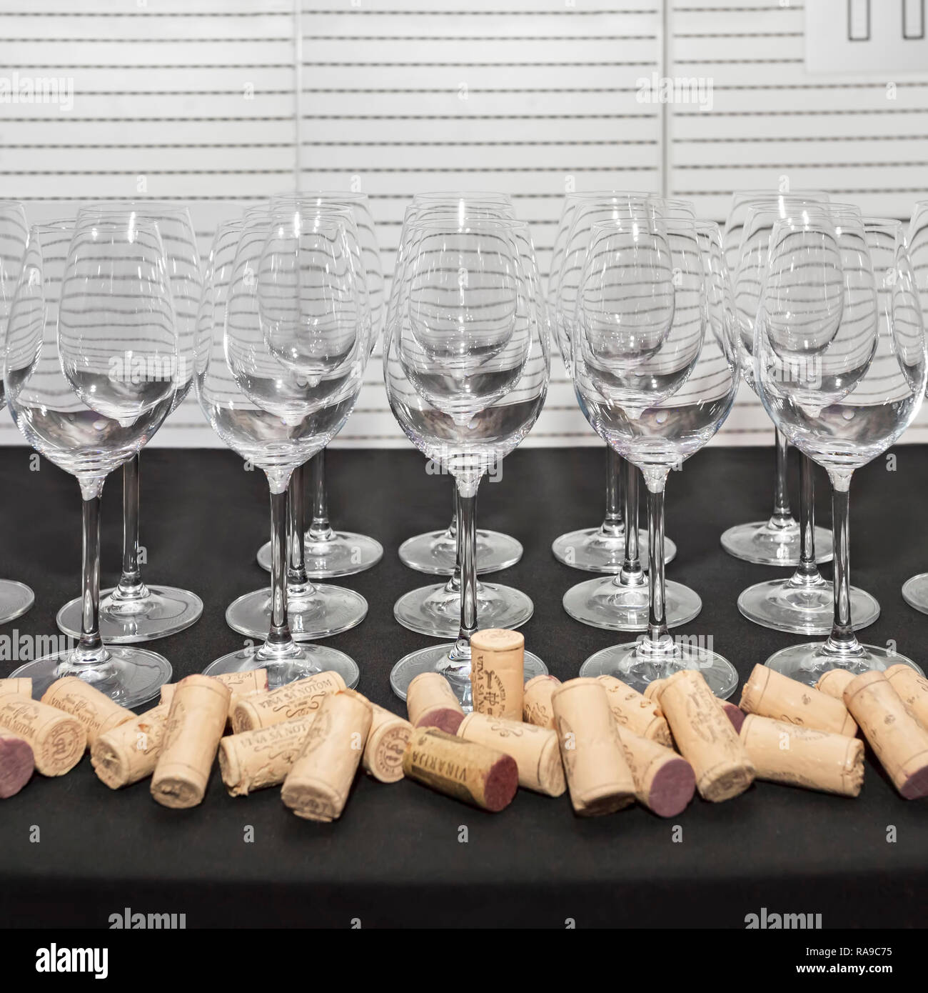 36bf626cf3ae5f Empty white wine glasses decoration with wine corks ready for testing wine
