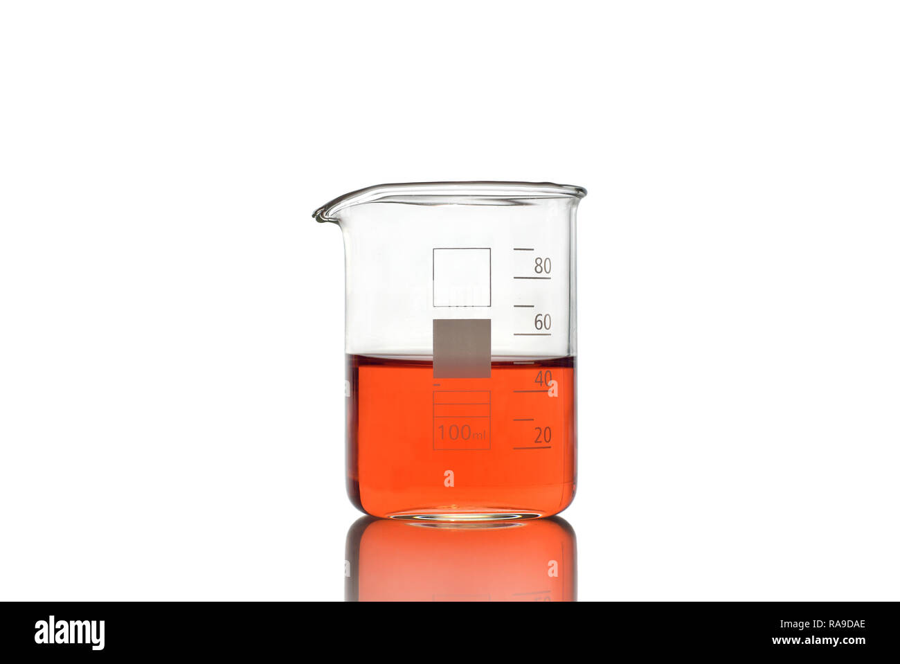 Beaker with red liquid on white background - Stock Image