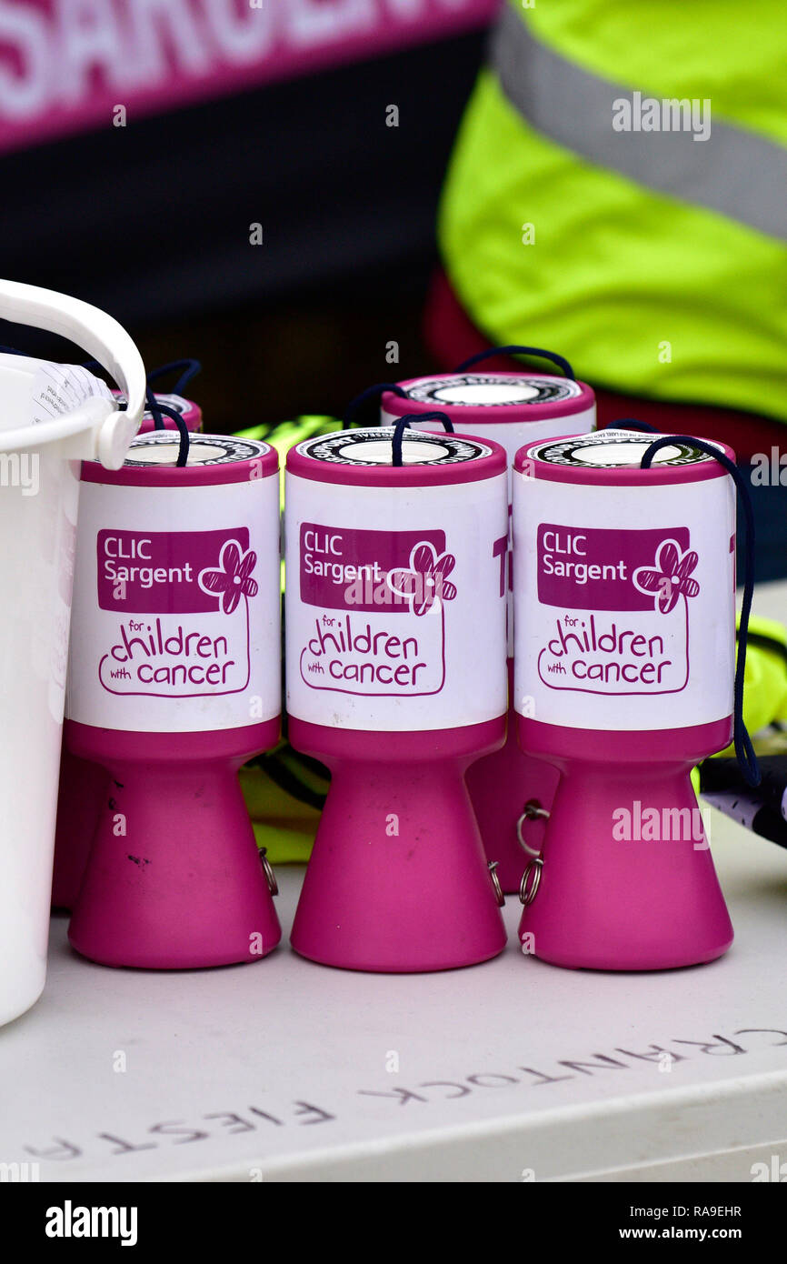 Collecting boxes tins for theb CLIC Sargent charity supporting children with cancer. - Stock Image