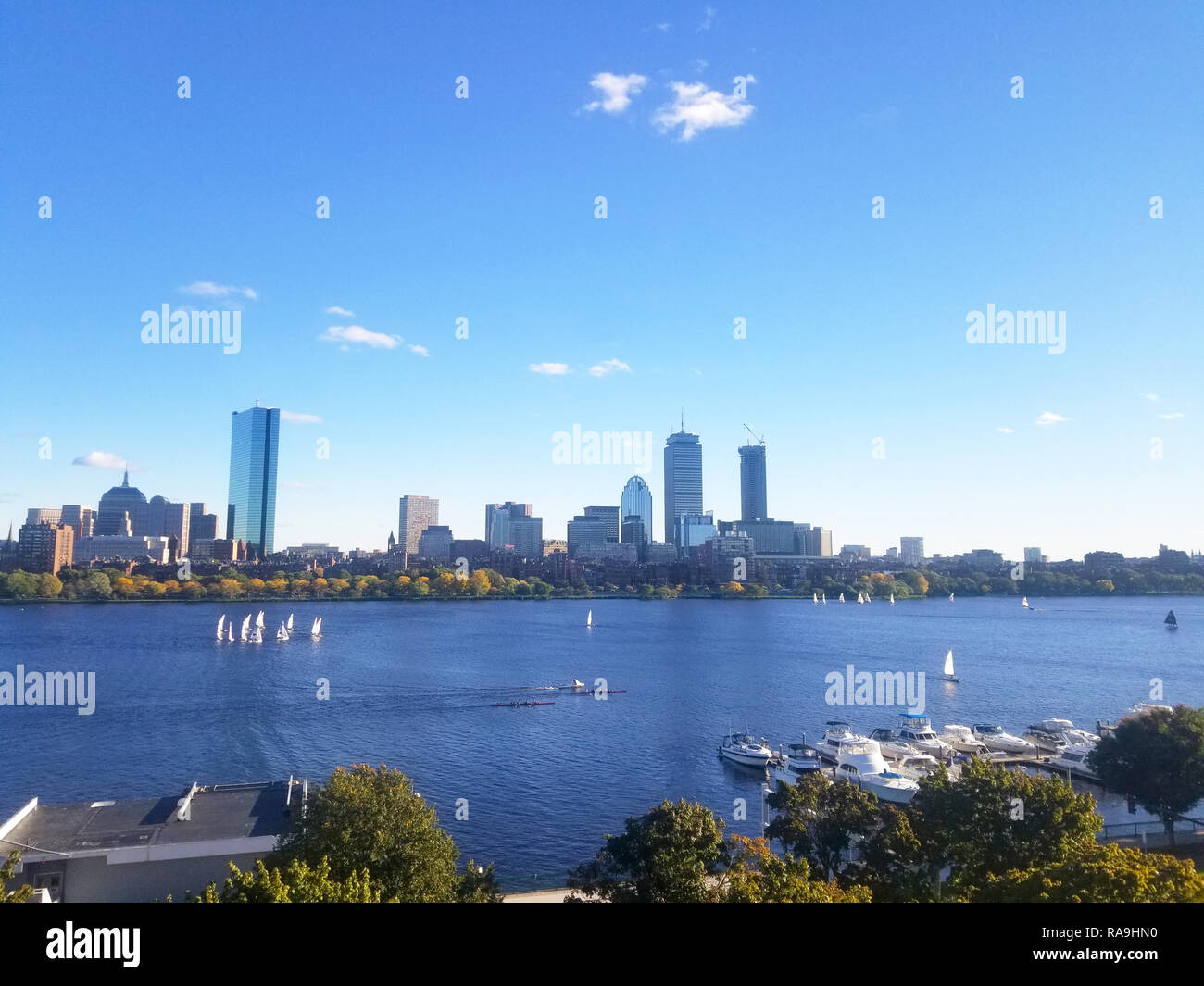 Boston Skyline Across the Charles River. On a sunny day. Boats on the river. Stock Photo