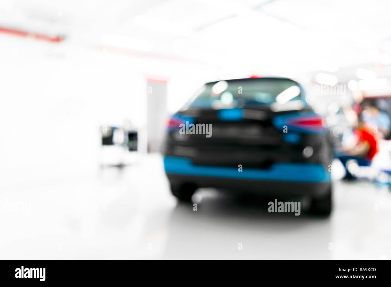 Blurred abstract image of man worker with car in body shop