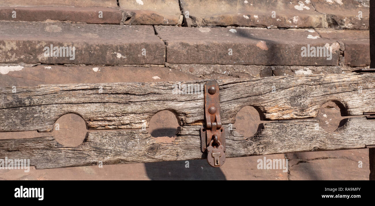 Stocks at The Cross in the village of Lymm, Cheshire, England, UK. - Stock Image