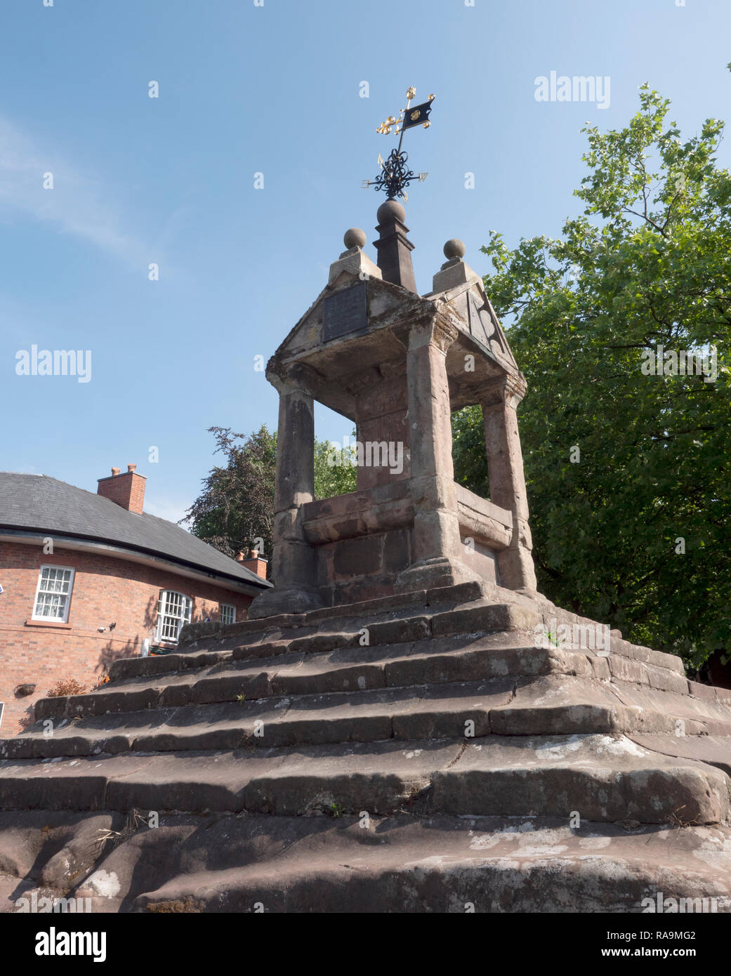 Lymm Cross at the centre of the village Lymm, Cheshire, England, UK. - Stock Image