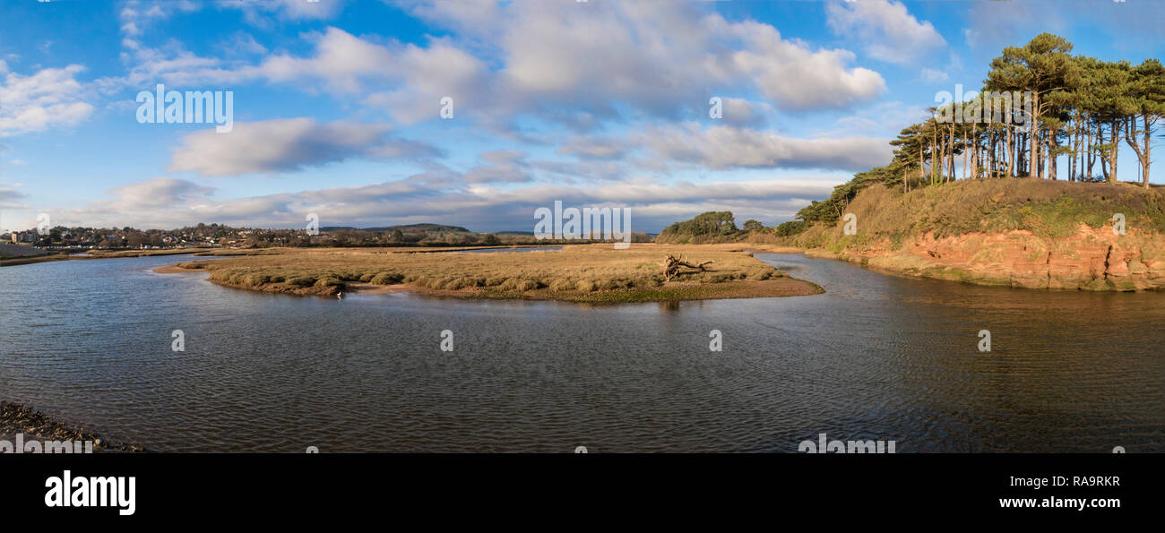 The River Otter Estuary Nature Reserve and salt marshes as it reaches the sea at Budleigh Salterton, Devon, UK. - Stock Image